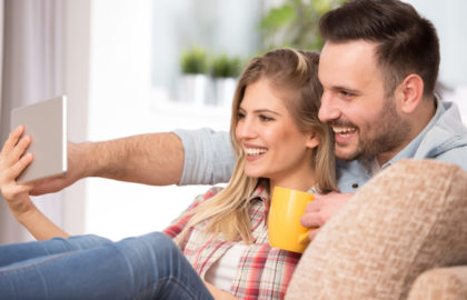 Young couple looking at tablet at home