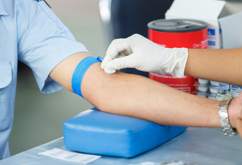 Nurse collecting a blood from a patient